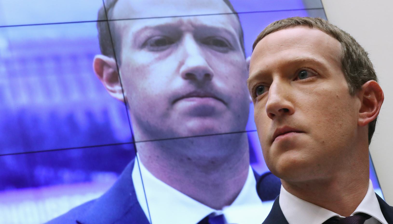 zuckerberg staring in the distance and pouting