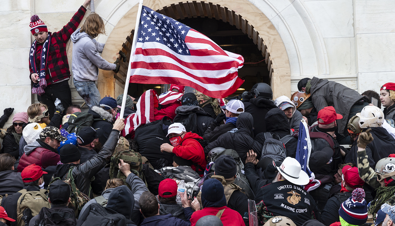 Insurrectionists pile on top of one another at the US Capitol on Jan. 6, 2021.