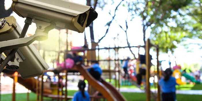 Surveillance camera near a playground