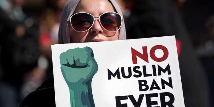 "Protestor holding ""No Muslim Ban Ever"" sign"