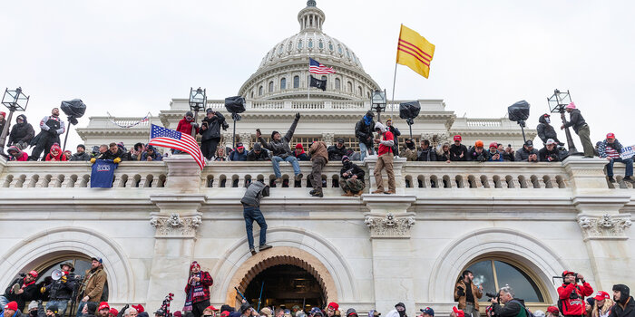 Pro-Trump rioters storm the Capitol.