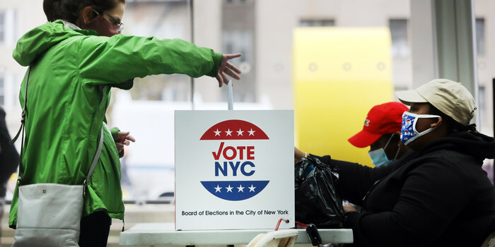 Woman casts a ballot in a New York City election.