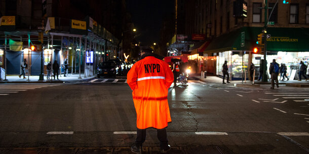 NYPD officer in an orange jacket.
